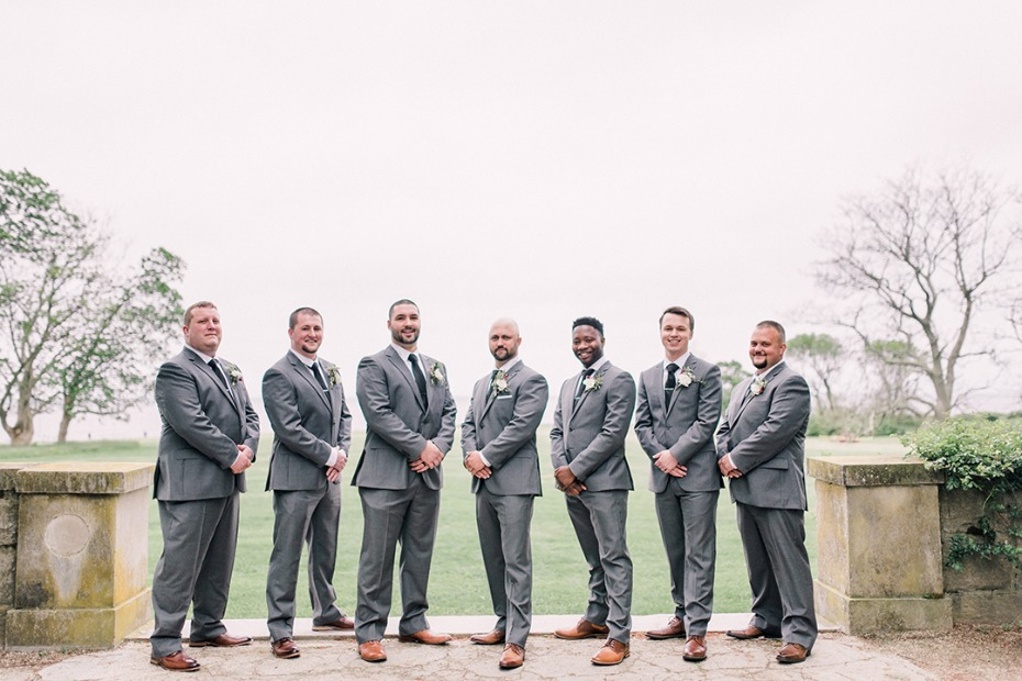 groom and his men in grey suits