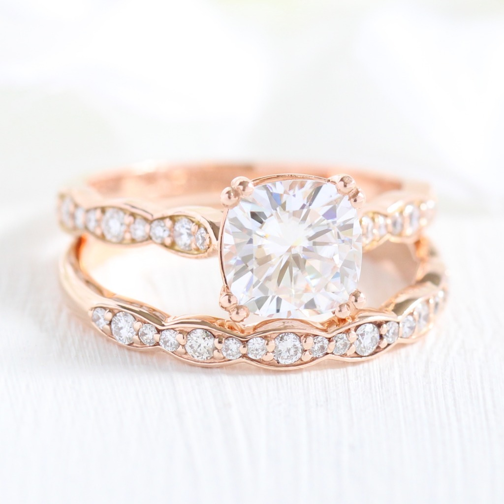 A new La More Design beauty! A solitaire Cushion Engagement Ring in Scalloped Diamond Band, paired with its matching wedding band