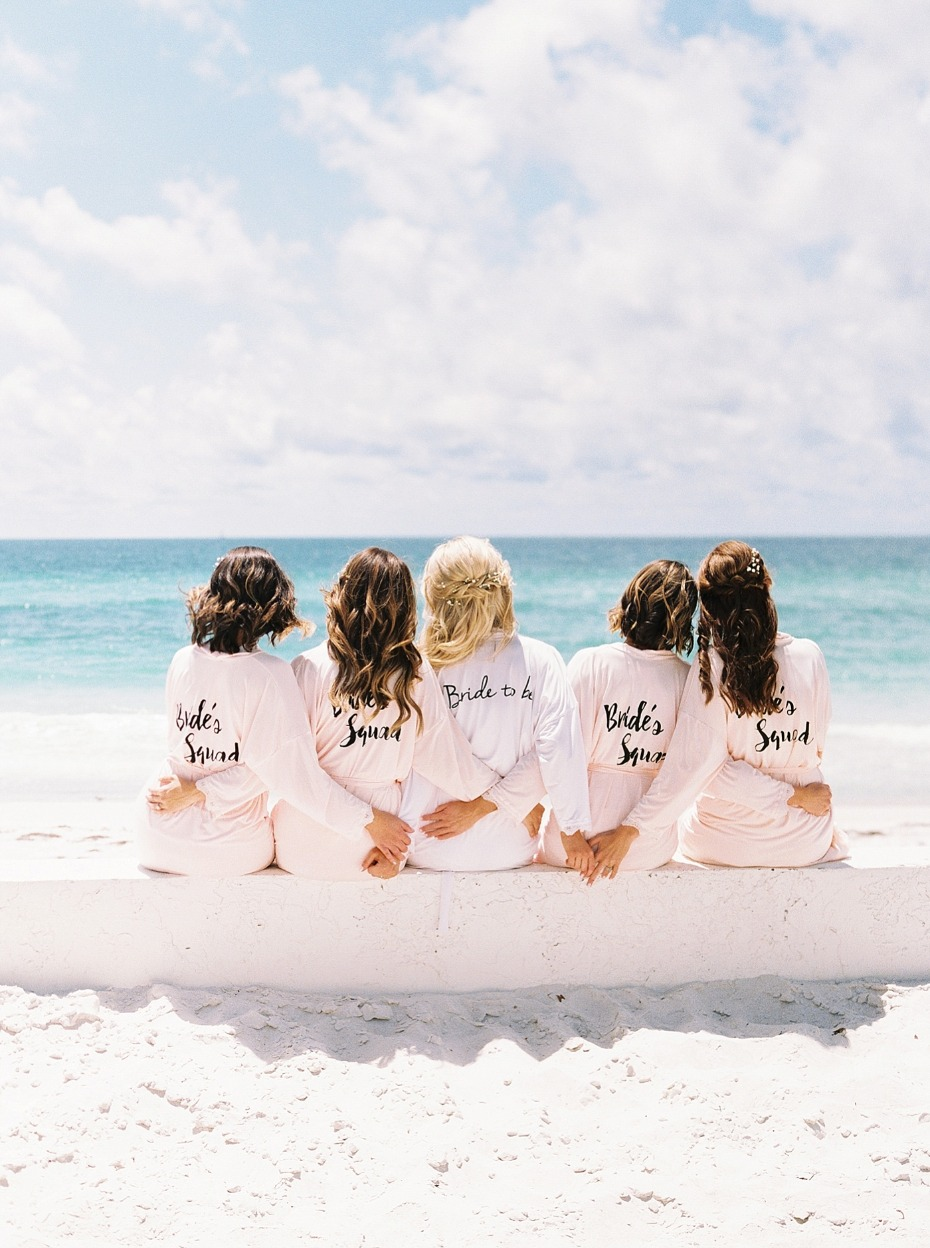 a bridal party on the beach