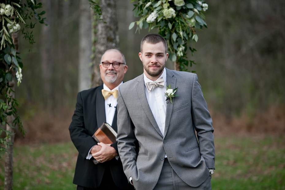 groom in grey and neutral bow tie