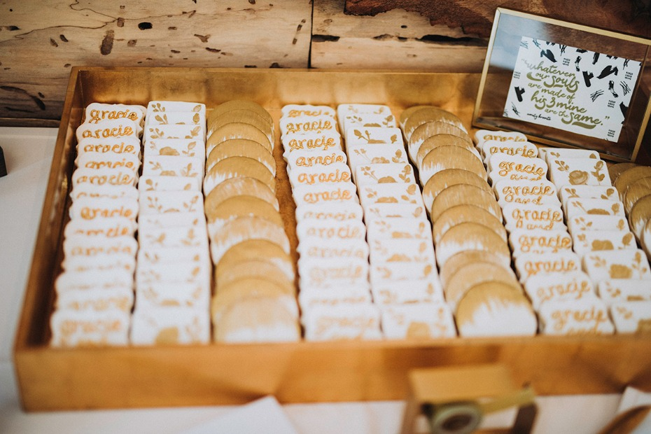 gold and white frosted wedding cookies
