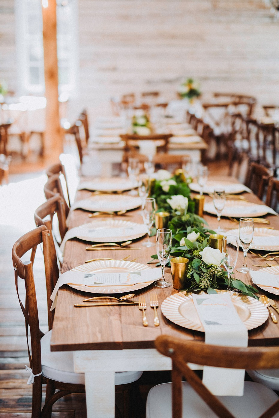wedding table decor with farm table and gold flatware