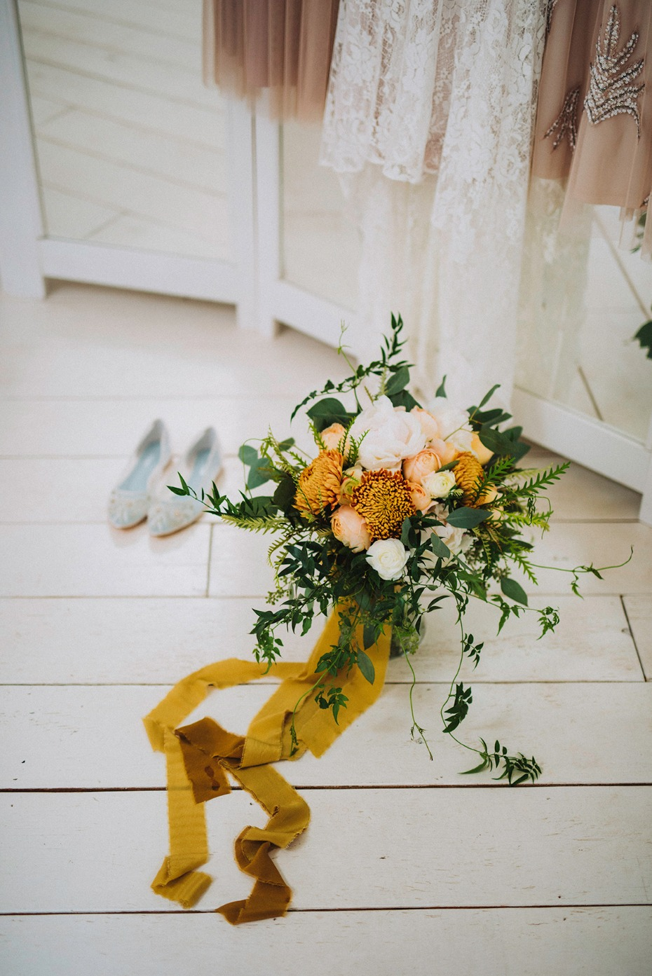 wedding bouquet with mustard ribbon wrap