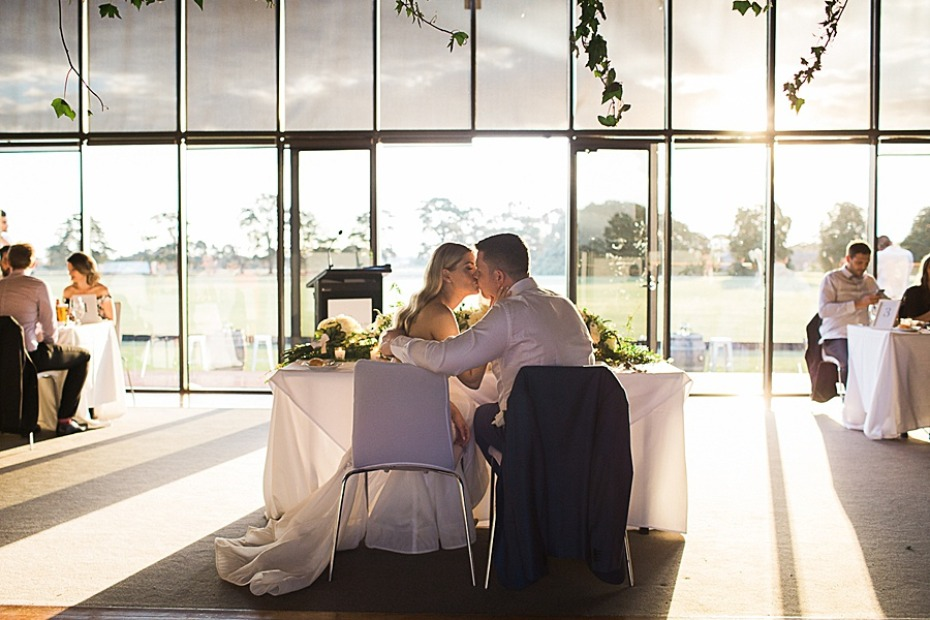 sweet sunset sweetheart table photo