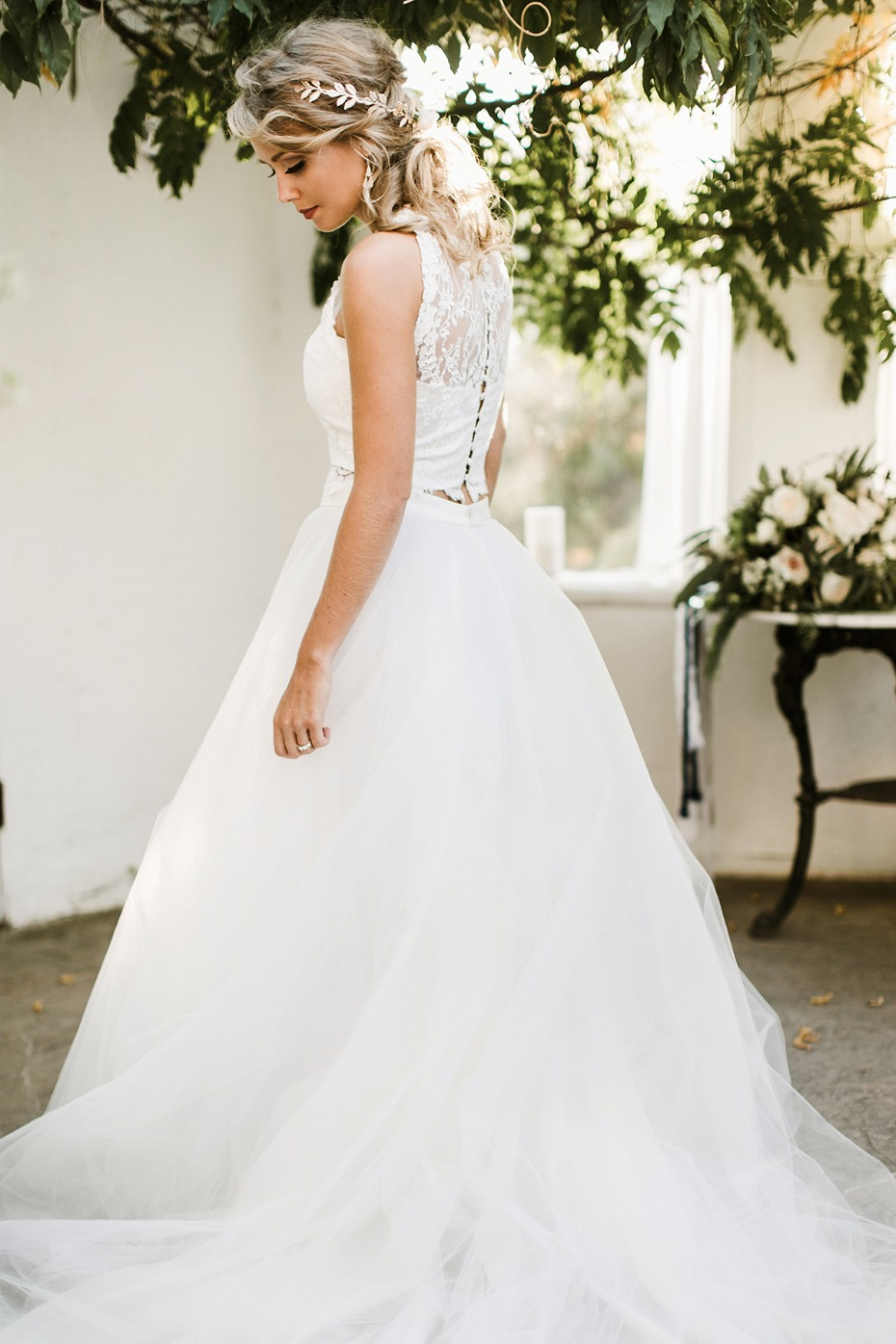 bride in two piece wedding dress and hair vines