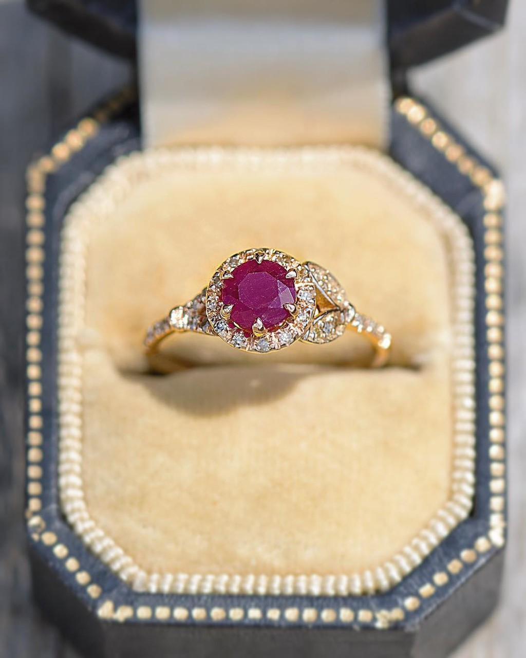 A very rare all natural, no-heat, raw Red Ruby mined in Wyoming State sits at the center of this glowing ring. So named after Wyoming