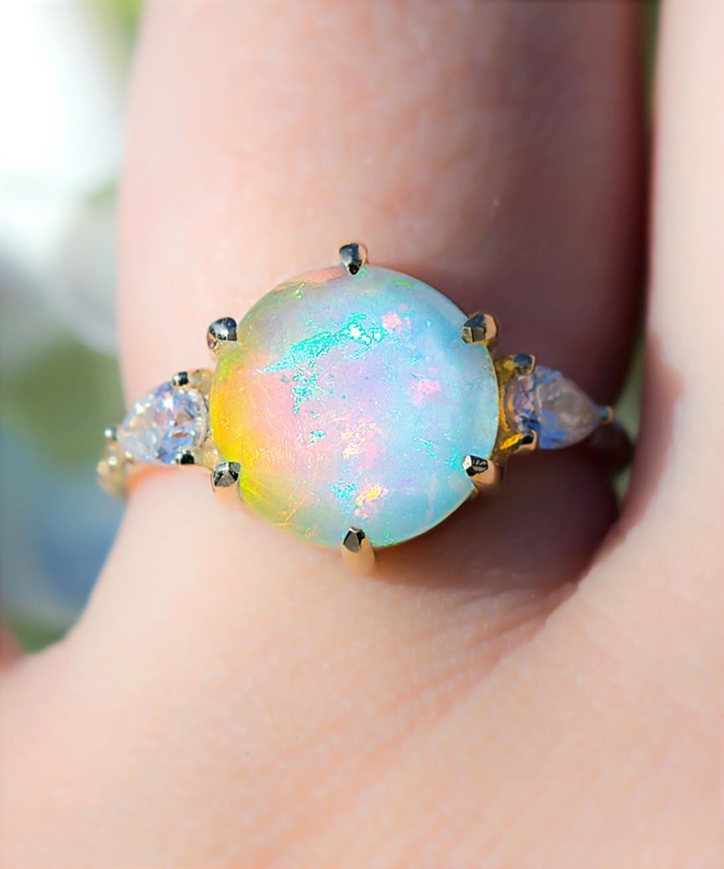 ✨🌈💗 I can't with this insane Opal... A glorious, bold, and vibrant 10mm round Ethically Sourced Opal sits at the center of