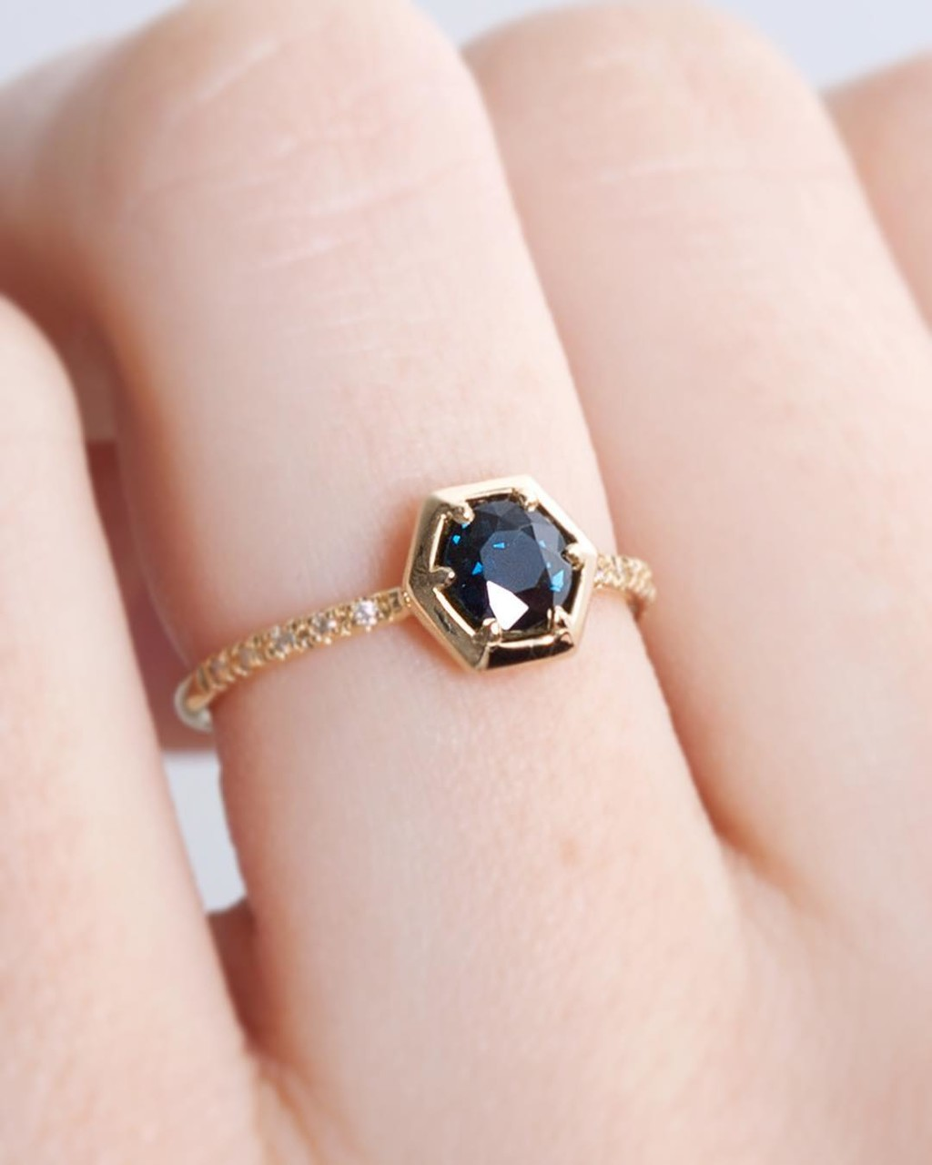This Sapphire is such a beautiful saturated deep blue color. 💙✨🌟Set in our low profile Harmonie Hexagon Collet frame ring