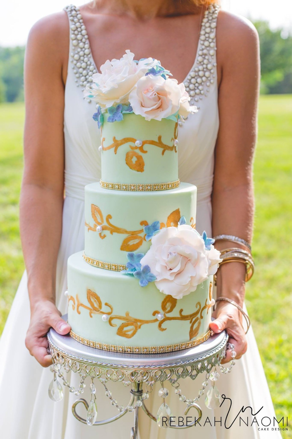 Wedding Day Pictures To Have & To Hold ... the bride holding her wedding cake! Opulent Treasures offers a collection of Wedding