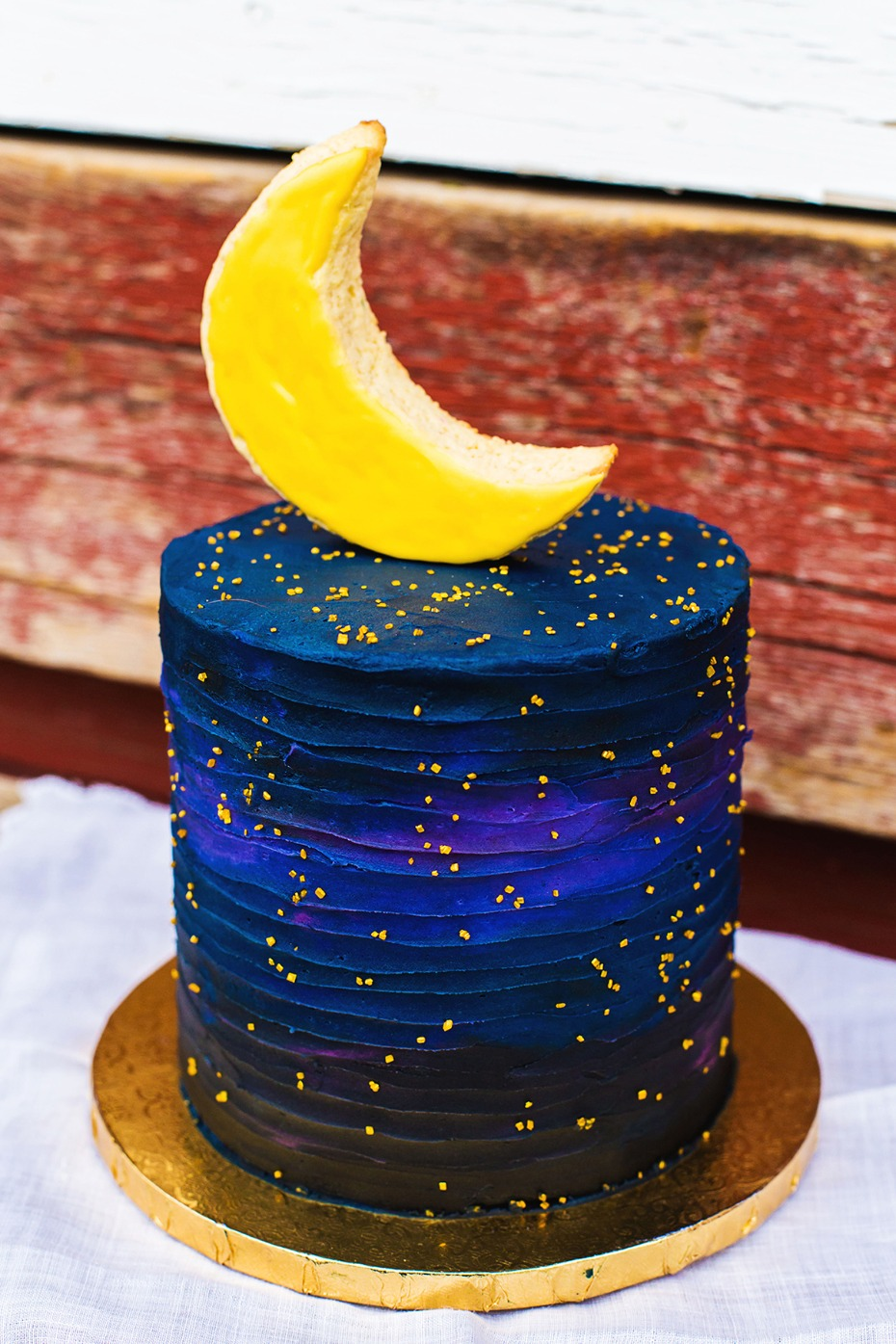 galaxy wedding cake with moon topper