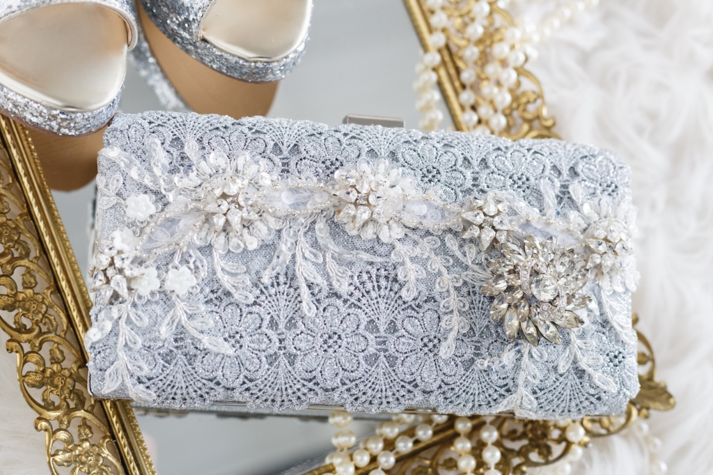 Couture bridal clutch designed with gorgeous silver laces and a vintage jewel.