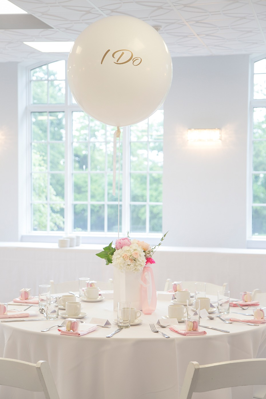 white and pink bridal shower with giant ballons