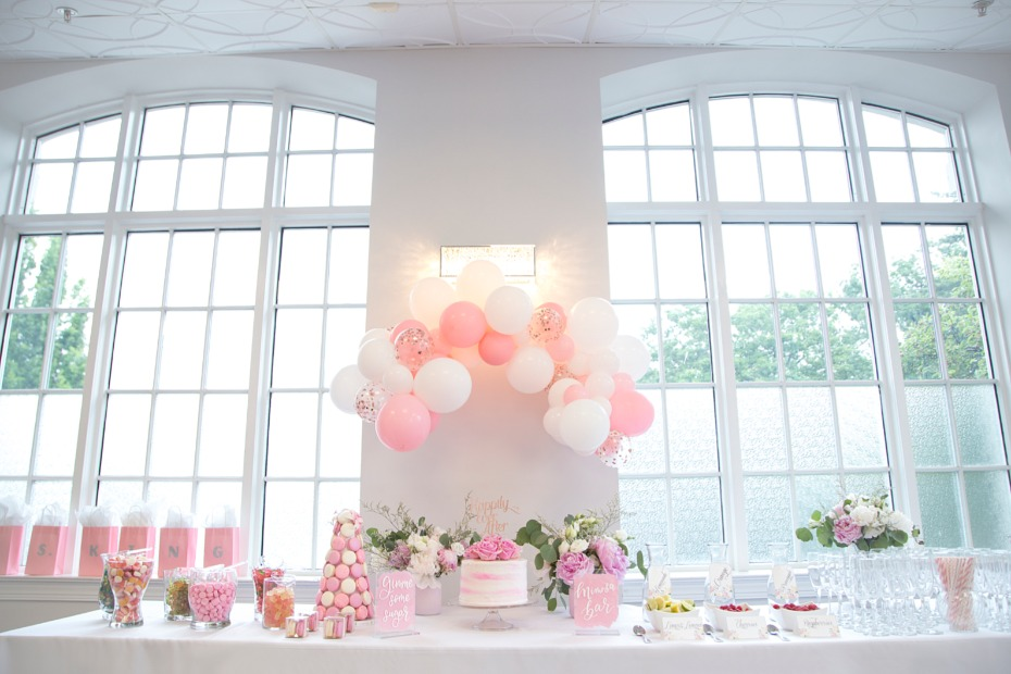 desert table with balloon arch for bridal shower