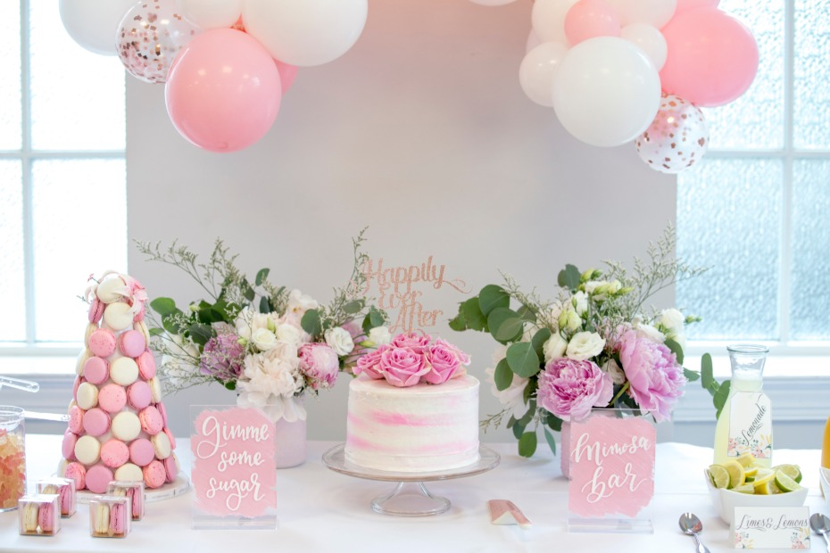 pink and white cake table for bridal shower