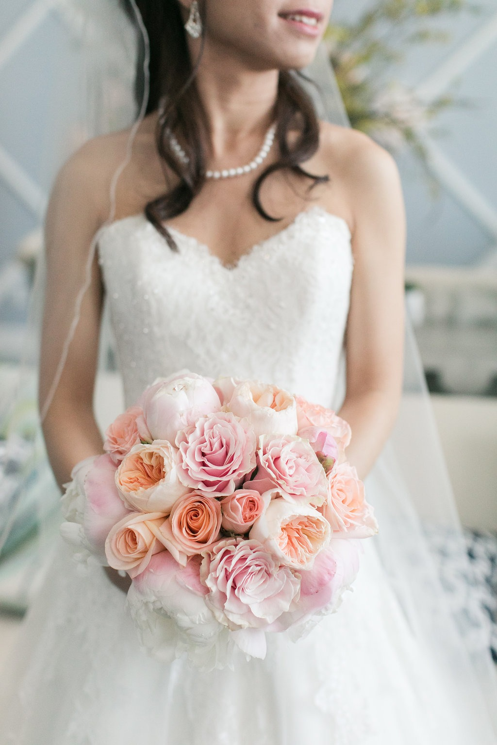 Beautiful in blush and white. Our bride looked gorgeous in her sweetheart neckline wedding dress and her bouquet of garden roses added