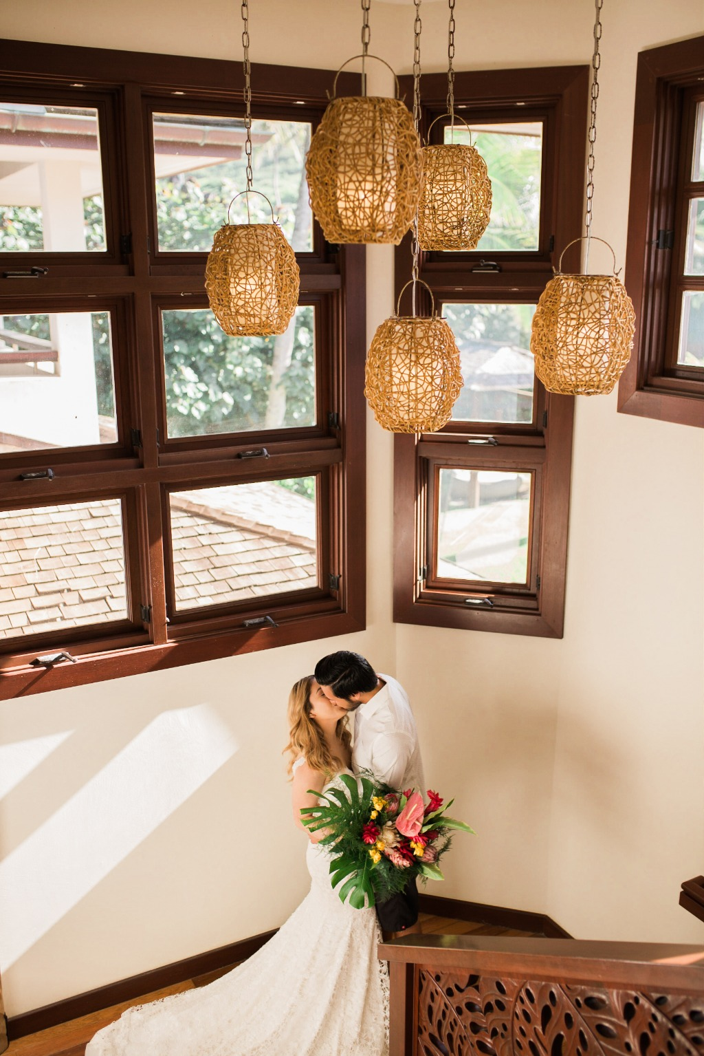 Tropical Bouquets and a staircase make for beautiful couples portraits!