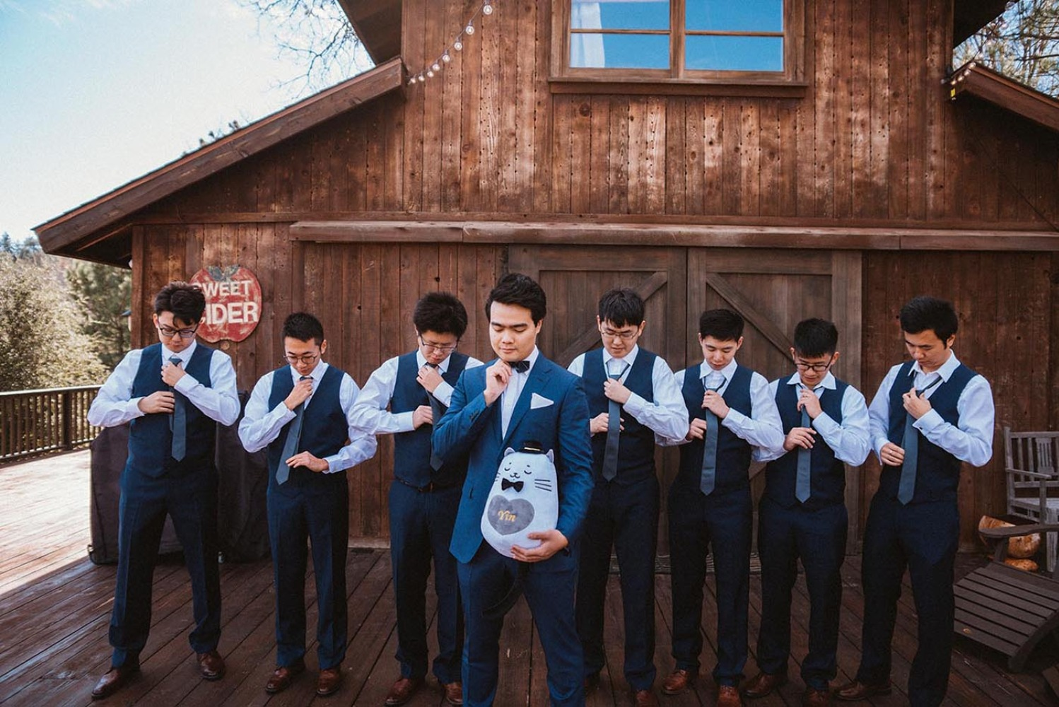 groom and his men in navy blue