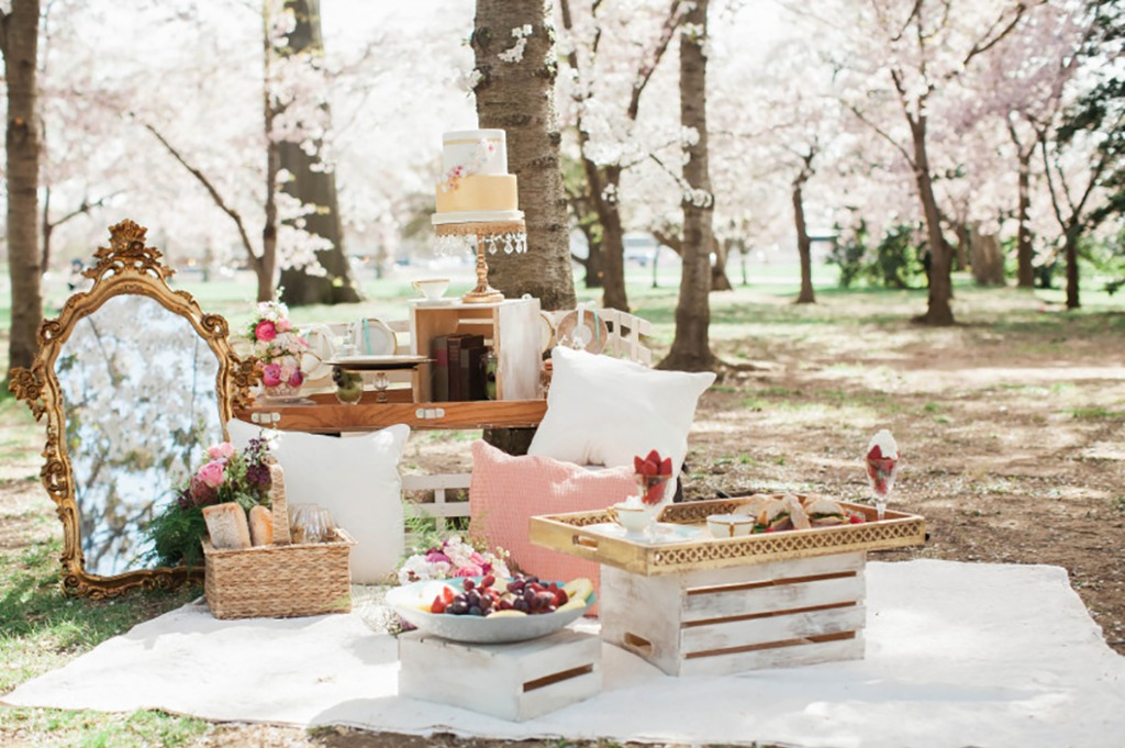 Love this wedding day picnic lounge with Opulent Treasures antique gold chandelier cake stand ~ Photo: Candice Adelle Photography
