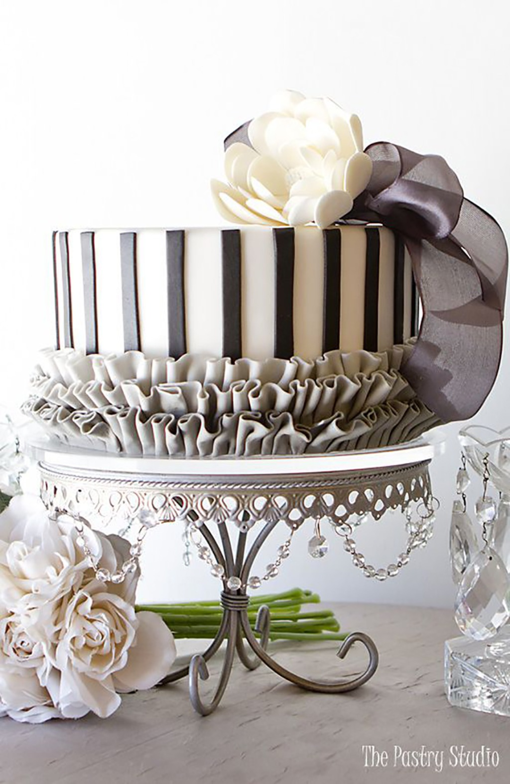 Shades of grey and silver ~ Ruffled Wedding Cake created by The Pastry Studio / Antique silver chandelier cake stand created by Opulent