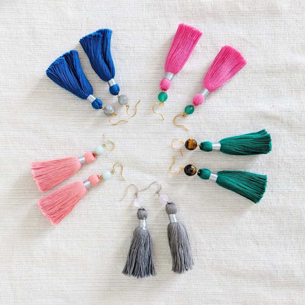 A rainbow of tassel earrings! One for each of your bridesmaids, each pair as unique as they are. (Added bonus: they'll actually want