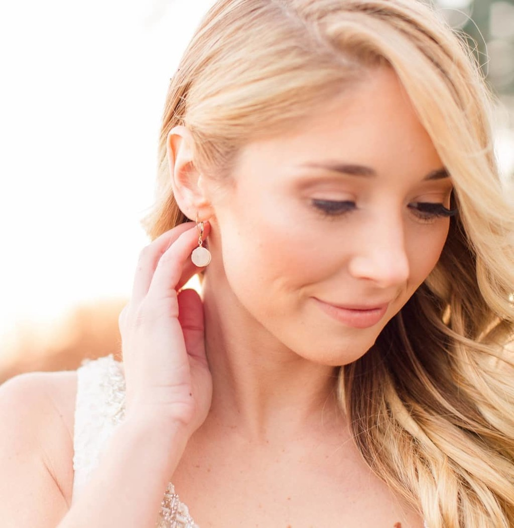 Styling tip: Pinning your hair back on one side is a great way to let your earrings shine while wearing your hair down in loose curls