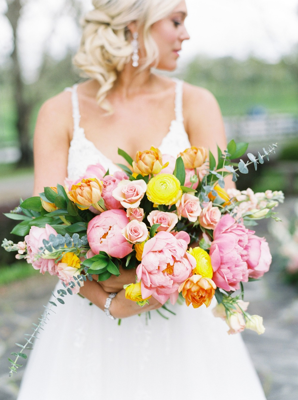 pink orange and yellow springtime wedding bouquet