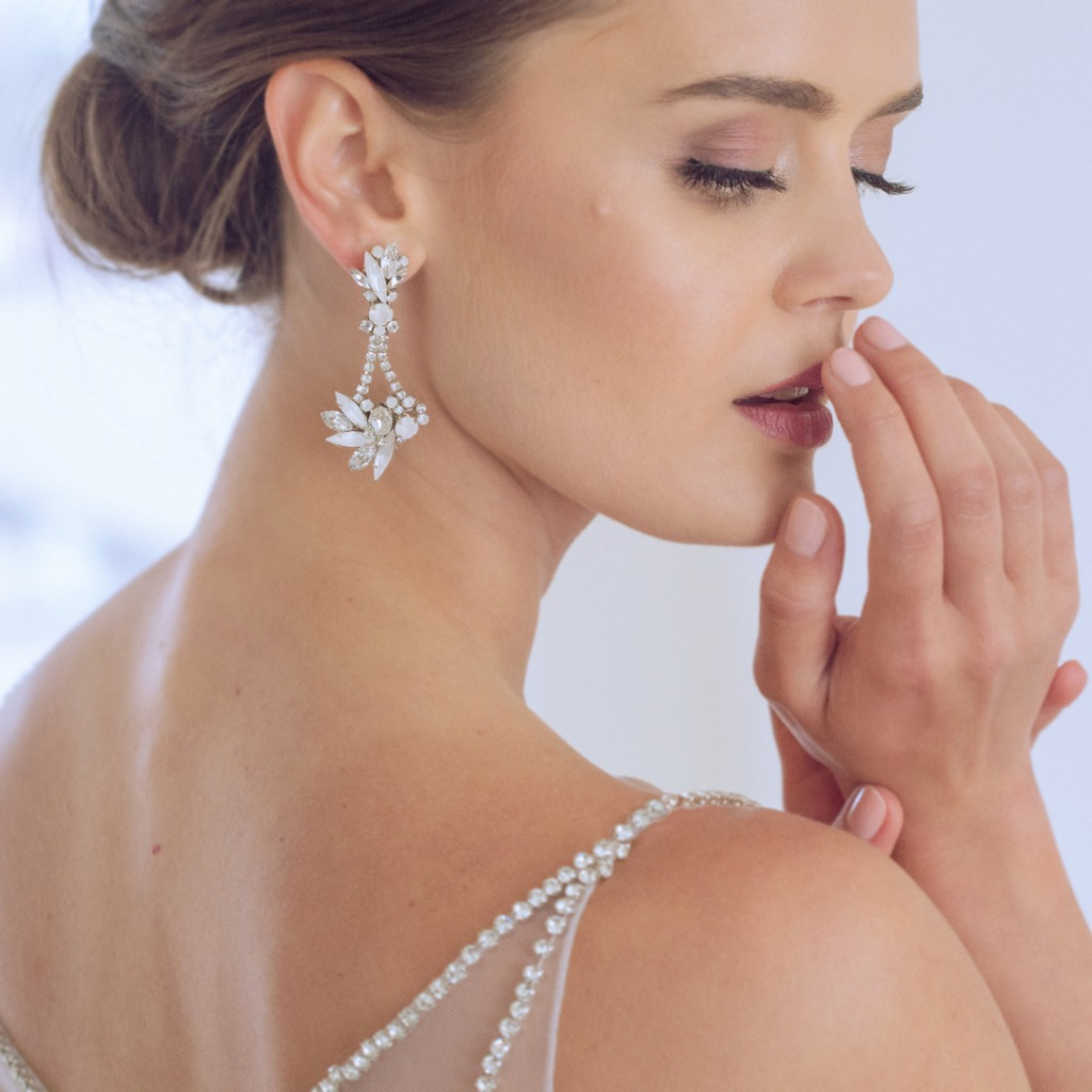 Unique jewelry for the bride and everyday. Shown: Chandelier earrings featuring crystals moonstones designed by Erin Cole.