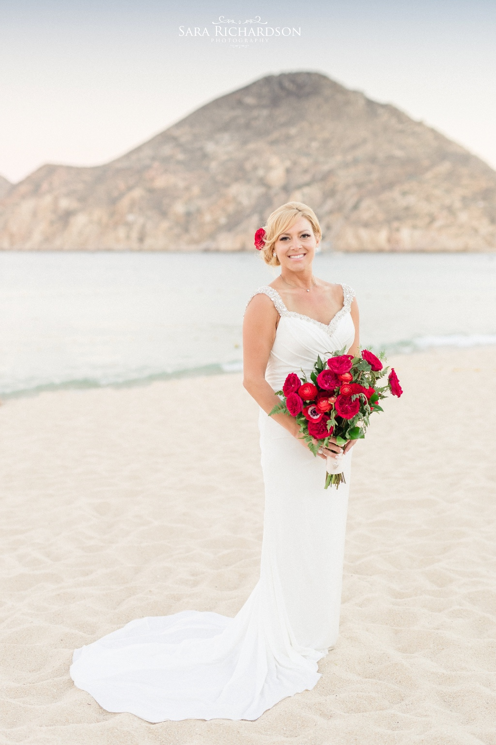Red bouquet for this beautiful Cabo Beach Wedding