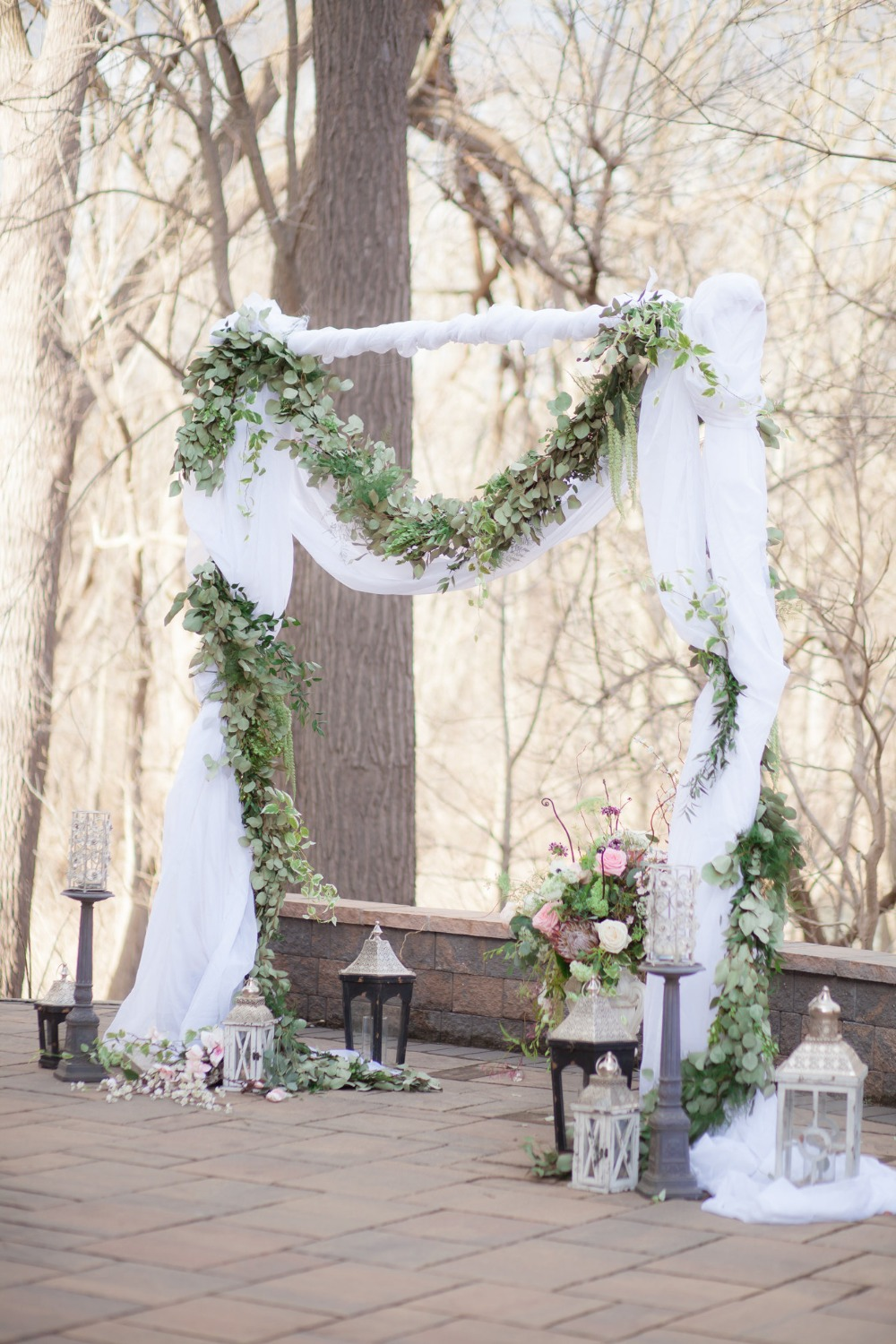 romantic greenery garland accented wedding arch