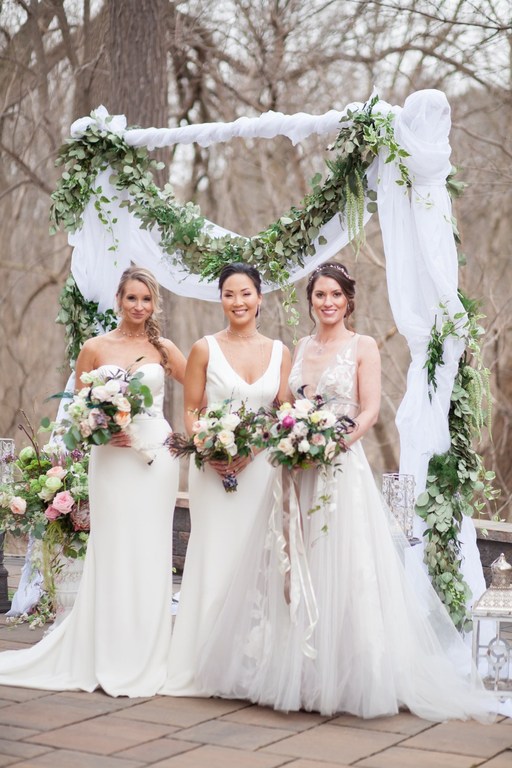 bride and bridesmaids in shades of white