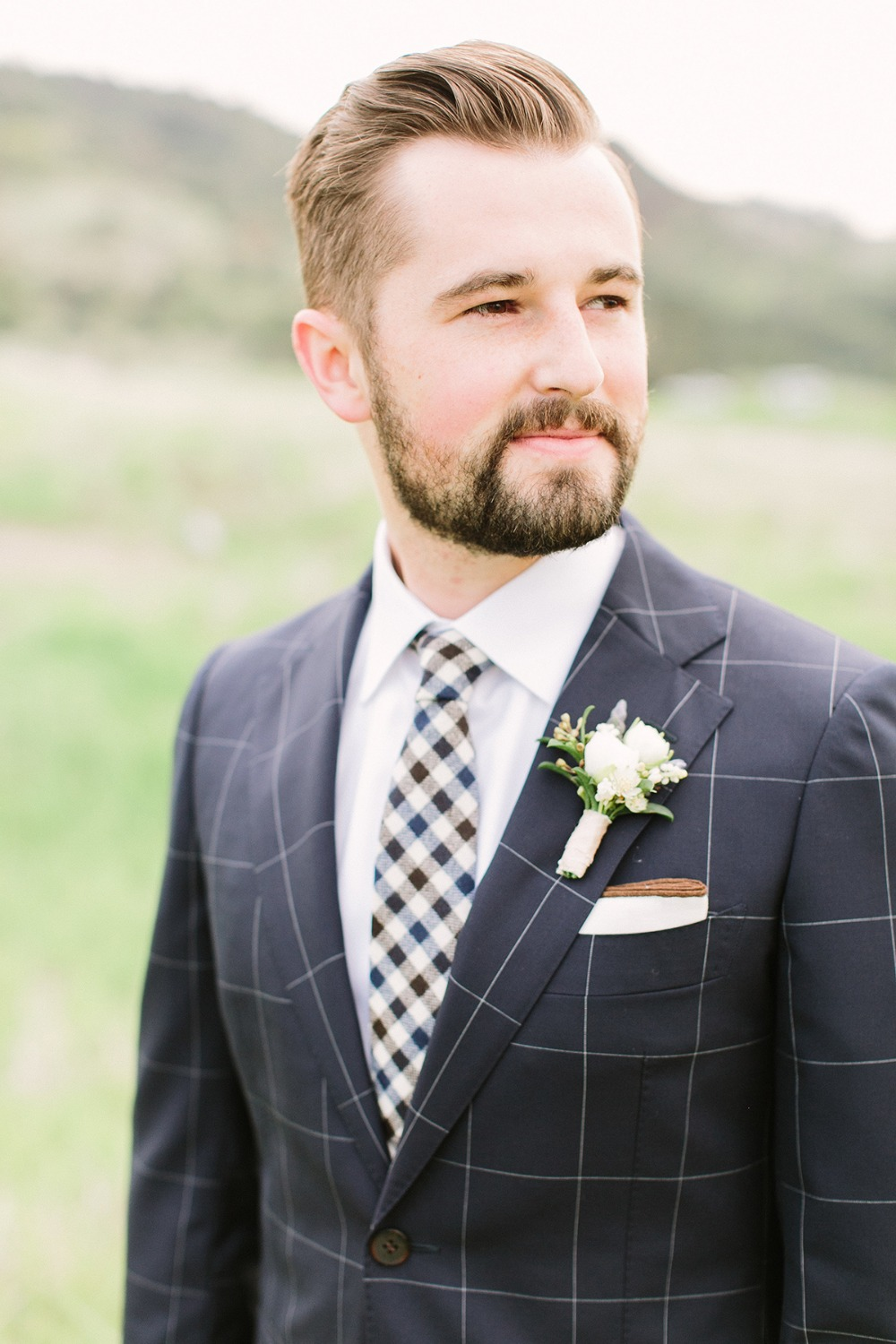 groom in navy checked suit