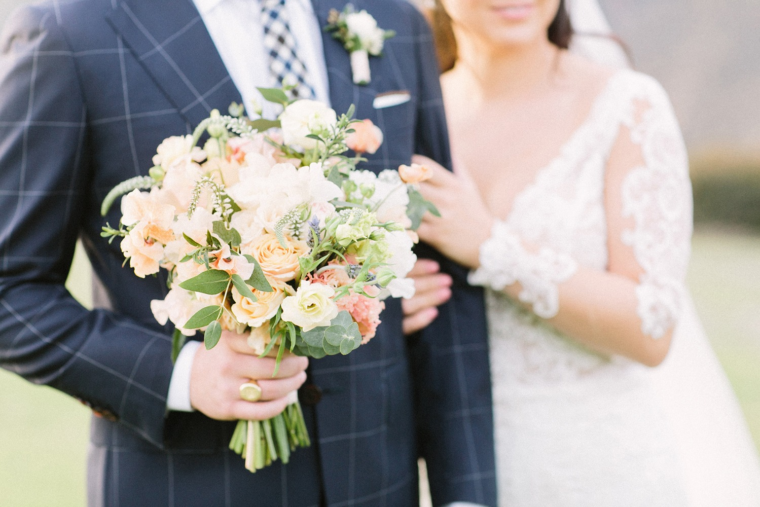 navy checkered suit and bouquet