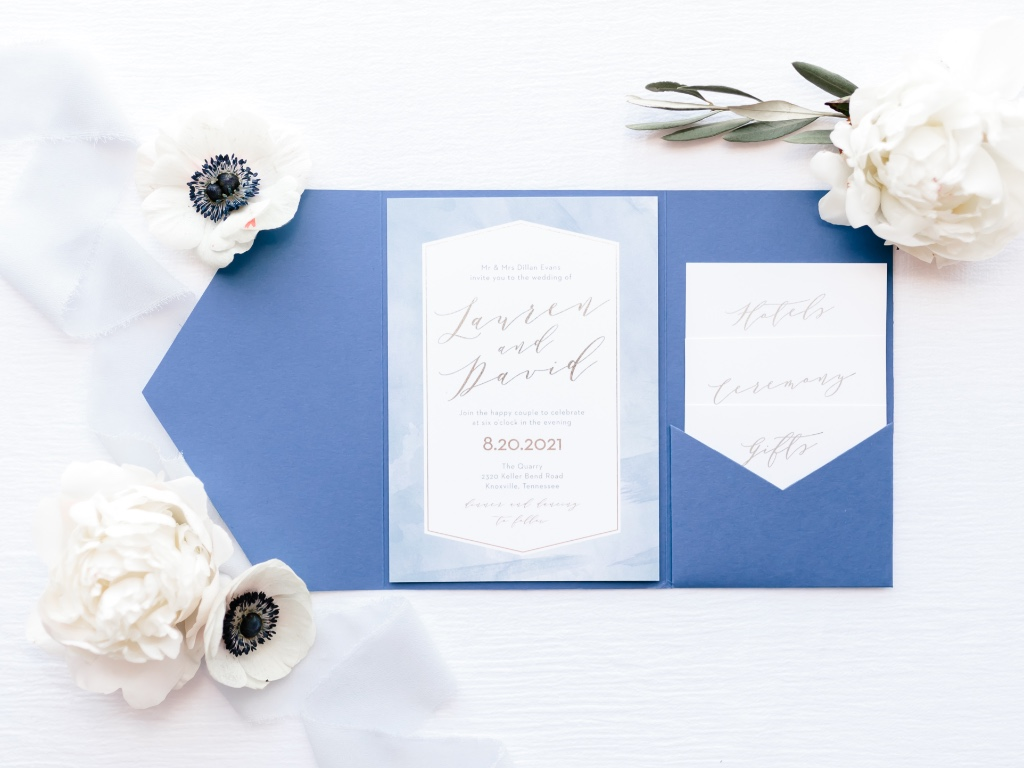 A picture perfect suite garnished in foil and a pretty blue pocket.