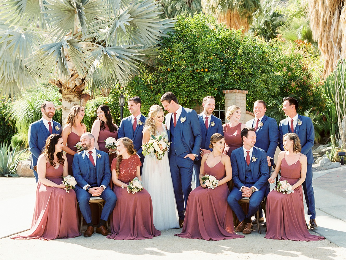 mauve bridesmaids and royal blue groomsmen