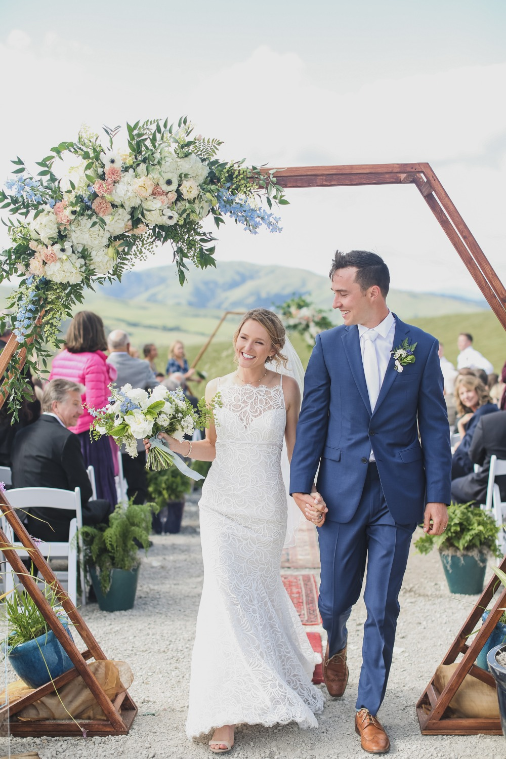hexagon wedding arch backdrop with florals