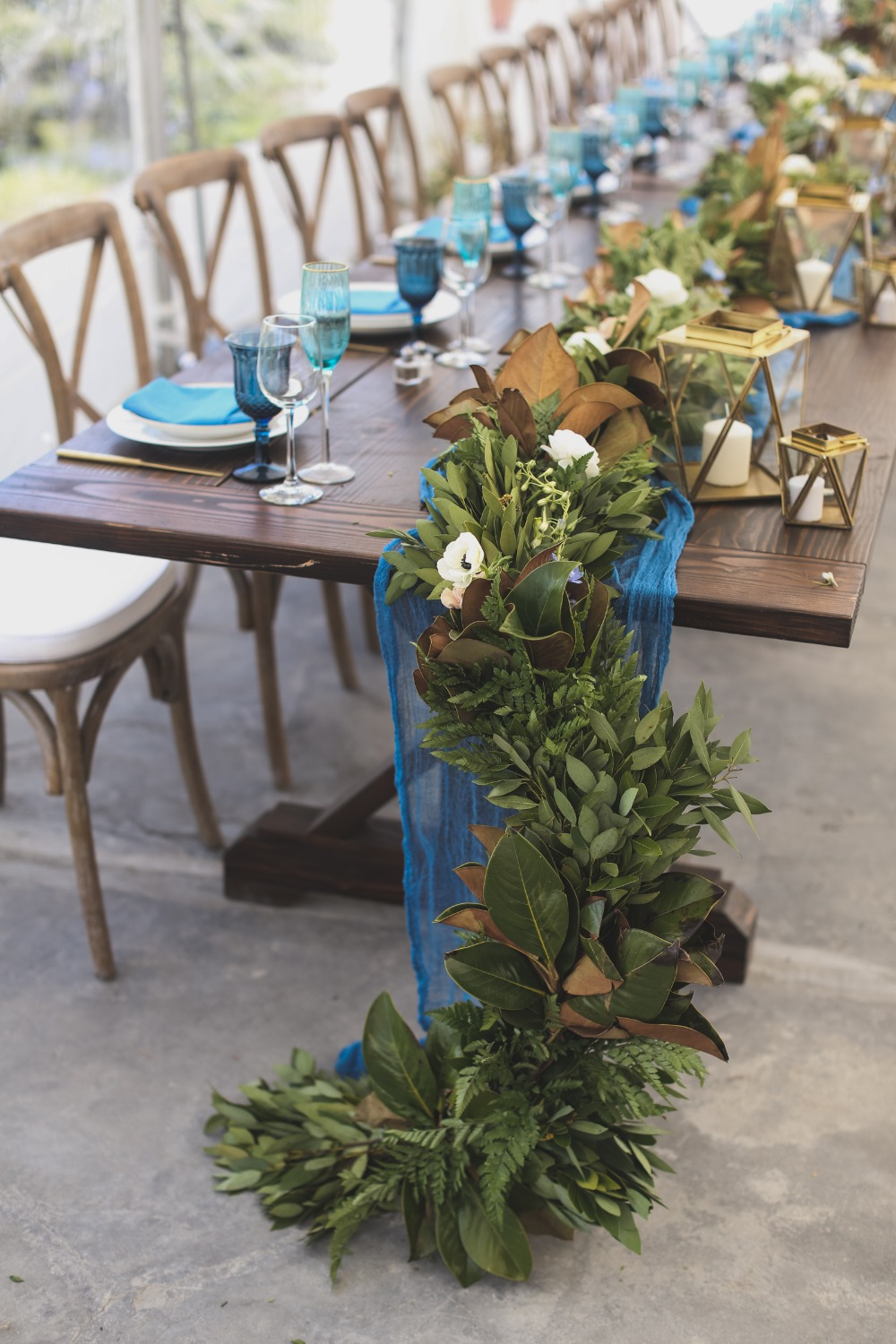 green garland with florals and hexagon candales