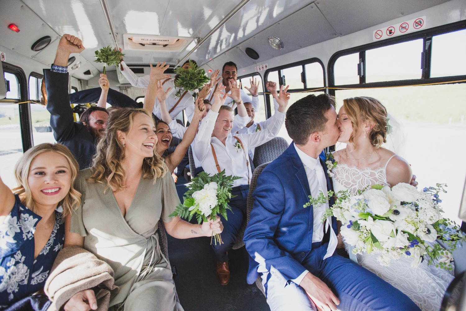 wedding party on a bust going to transportation