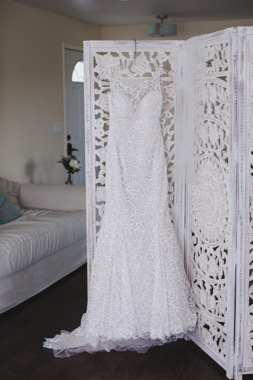 white dress with floral overlay