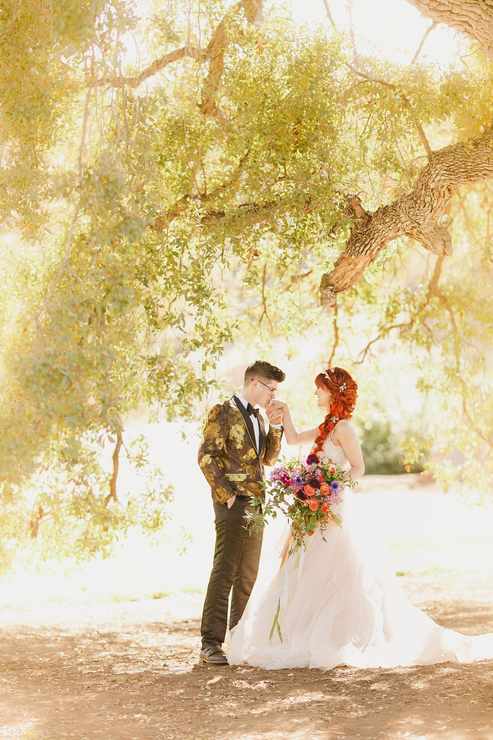 Floral Fairytale Shoot at Heavenly Oaks Flower Farm Groom Kissing Bride's Hand