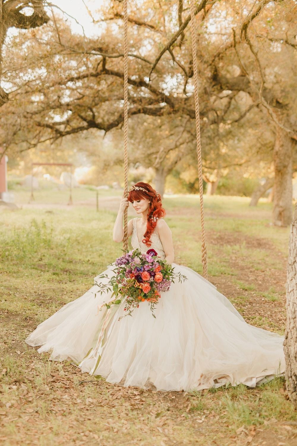 Floral Fairytale Shoot at Heavenly Oaks Flower Farm Bride on Swing