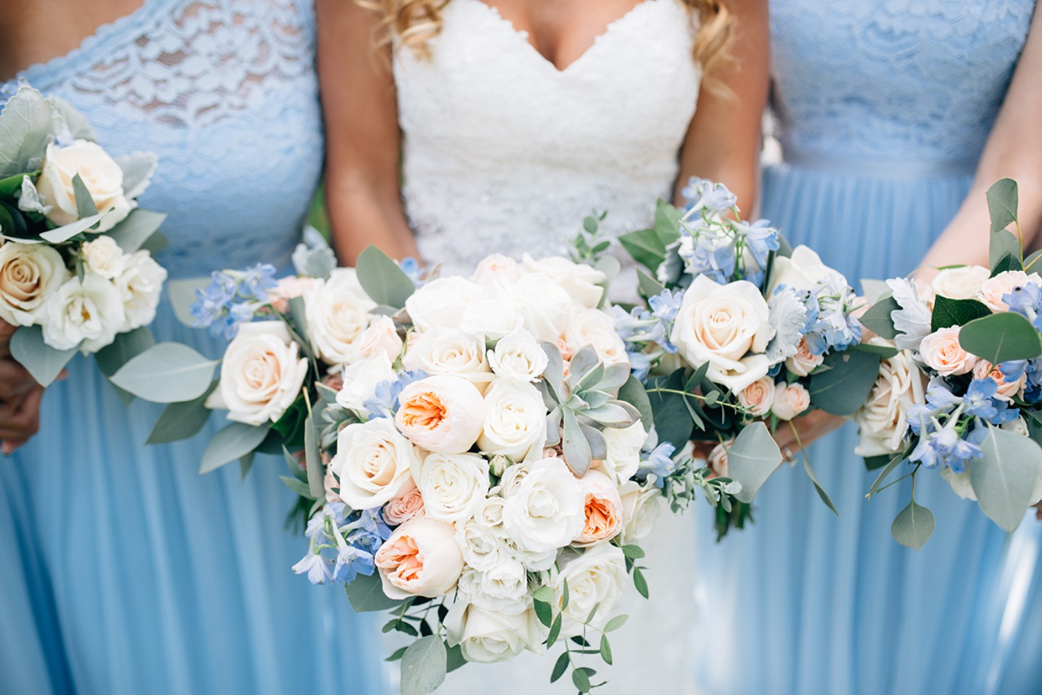 ice blue bridesmaids with blush and blue bouquets