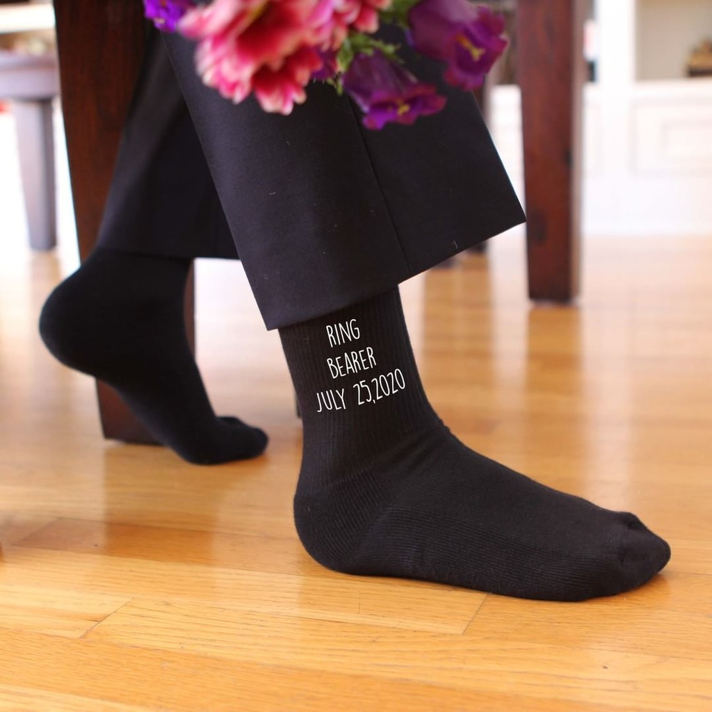 The true lord of the rings! Your ring bearer will definitely be comfortable on his journey down the aisle with these customized socks
