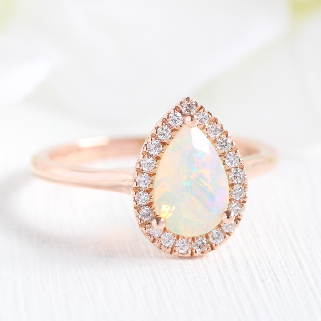The play-of-color in opals are so gorgeous, almost like a small rainbow on top of your finger ~ See more from our newly launched opals