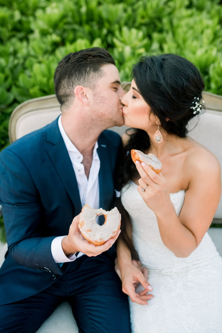 Cayman Island Beach Wedding Couple Kissing with Doughnuts