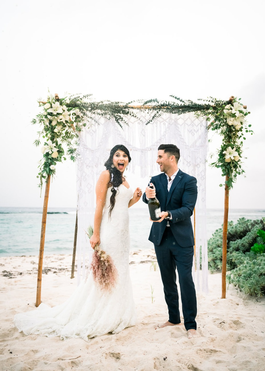 Cayman Island Beach Wedding Bride and Groom Popping Champagne
