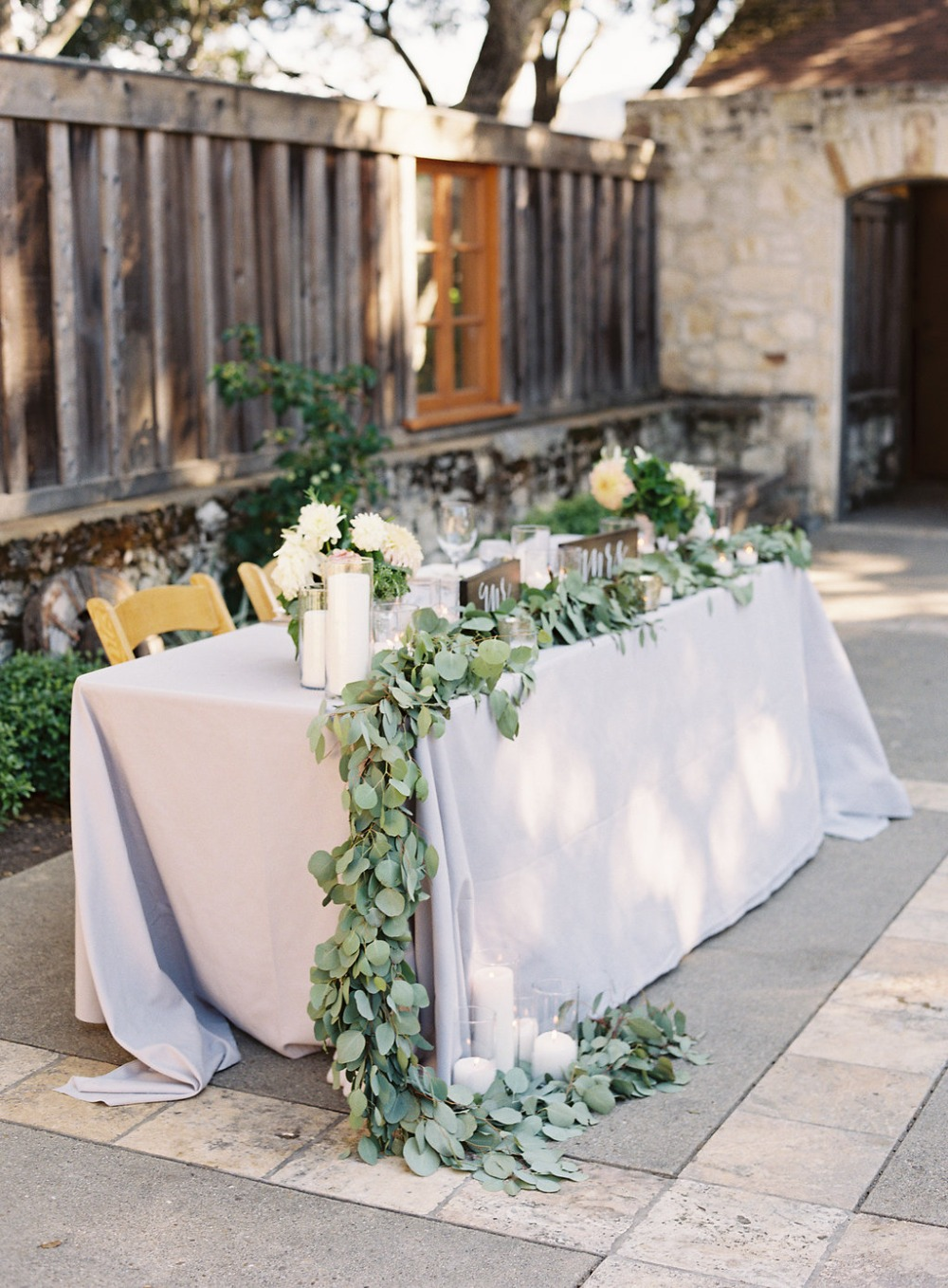 sweetheart table in grey and greenery