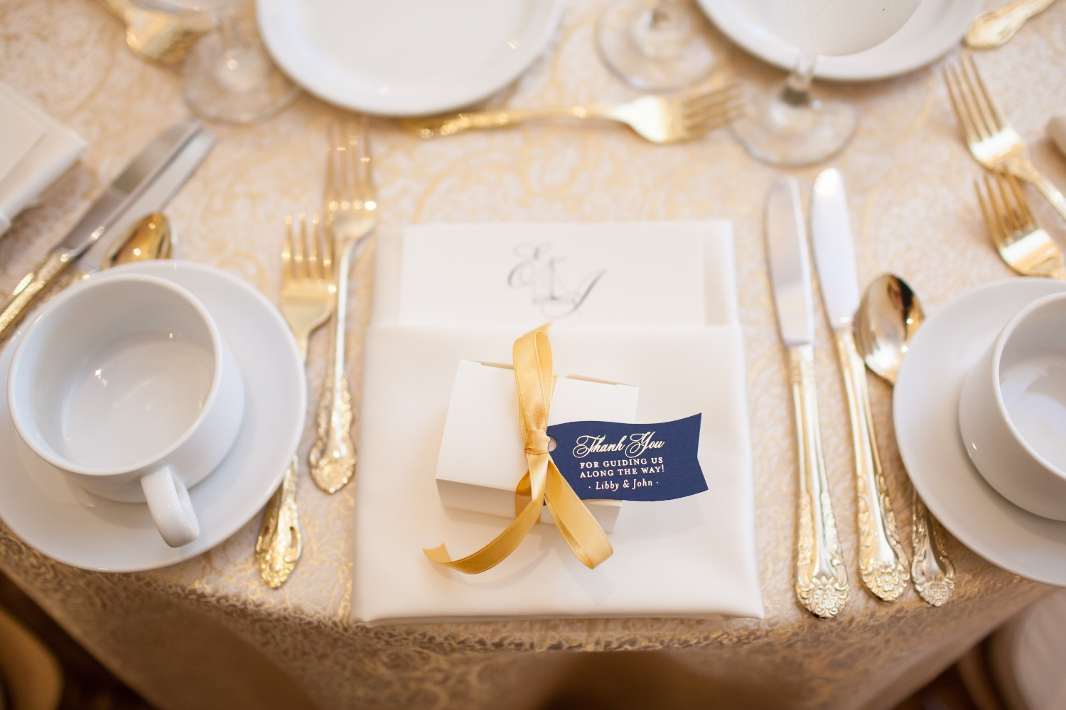 gold and white classic place setting