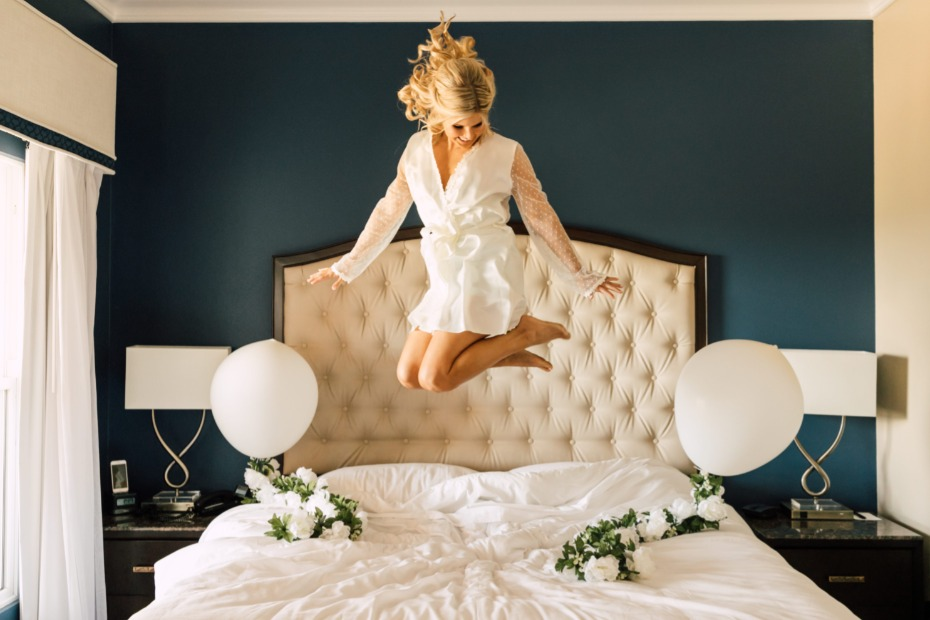 bride jumping on the bed