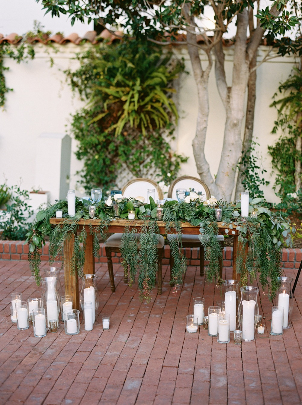 romantic cascading garland sweetheart table