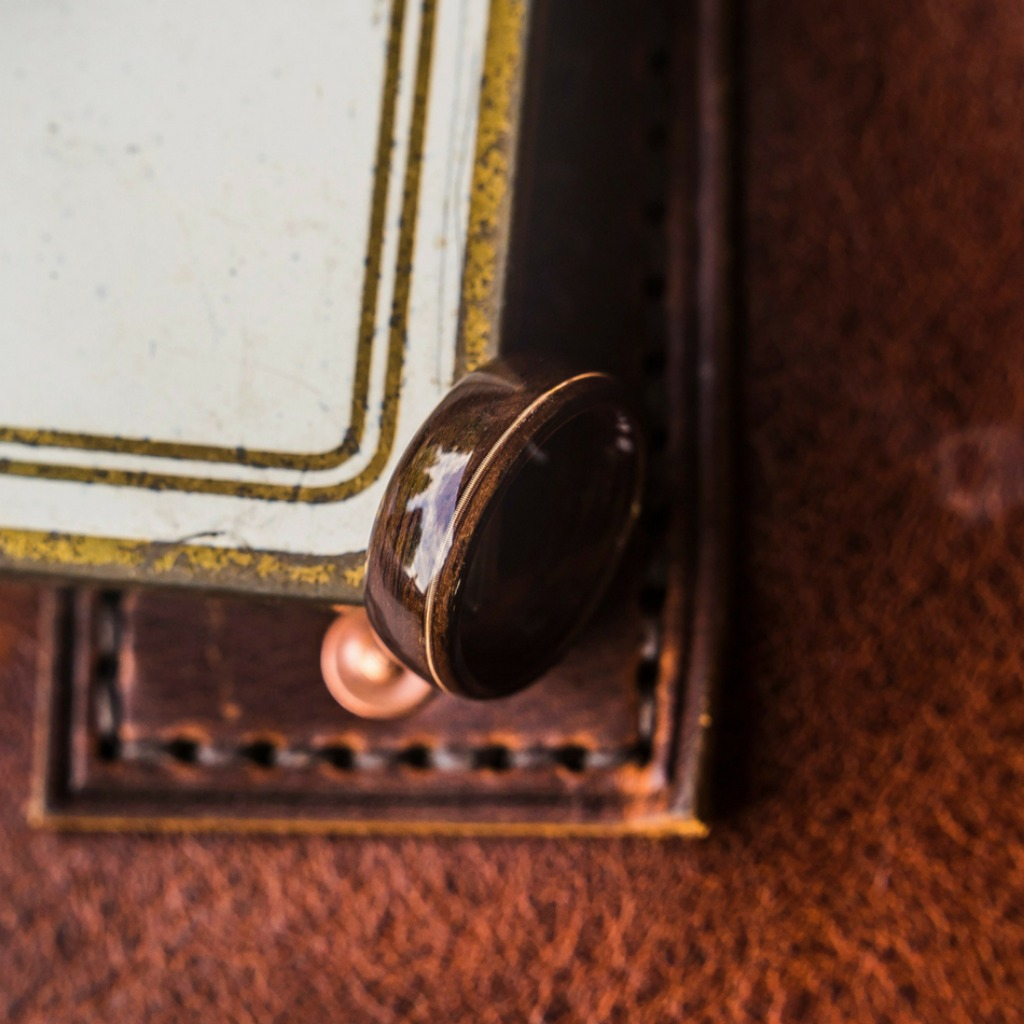 Mens bentwood wedding ring with a guitar string inlaid through the center of the ring.